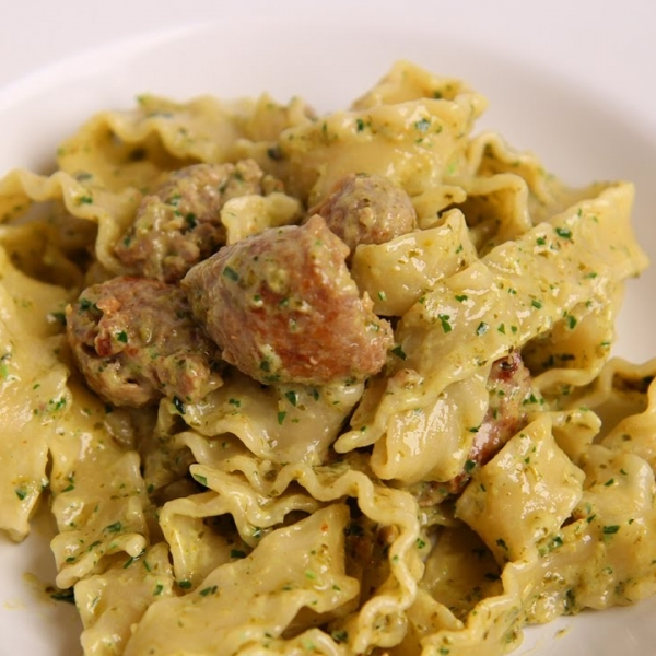 Pasta With Sausage in a Creamy Pesto Sauce